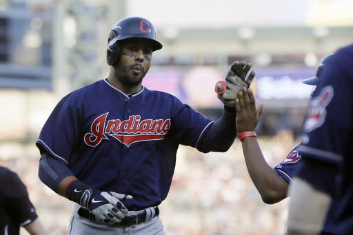 Cleveland Indians' Chris Dickerson is congratulated after his solo home run during the third inning in the second baseball game of a doubleheader against the Detroit Tigers, Saturday, July 19, 2014 in Detroit. (AP Photo/Carlos Osorio)