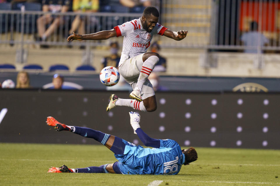 Philadelphia Union goalkeeper Andre Blake, left, defends the shot by Toronto FC defender Kemar Lawrence, right, during the first half of an MLS soccer match, Wednesday, Aug. 4, 2021, in Chester, Pa. (AP Photo/Christopher Szagola)