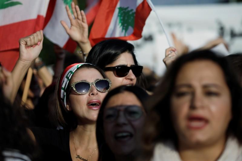 Demonstrators shout slogans at a feminist march during ongoing anti-government protests in Beirut