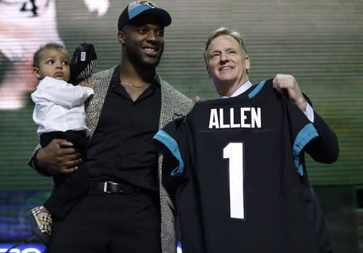Kentucky linebacker Josh Allen poses with NFL Commissioner Roger Goodell after the Jacksonville Jaguars selected Allen in the first round at the NFL football draft, Thursday, April 25, 2019, in Nashville, Tenn. (AP Photo/Mark Humphrey)