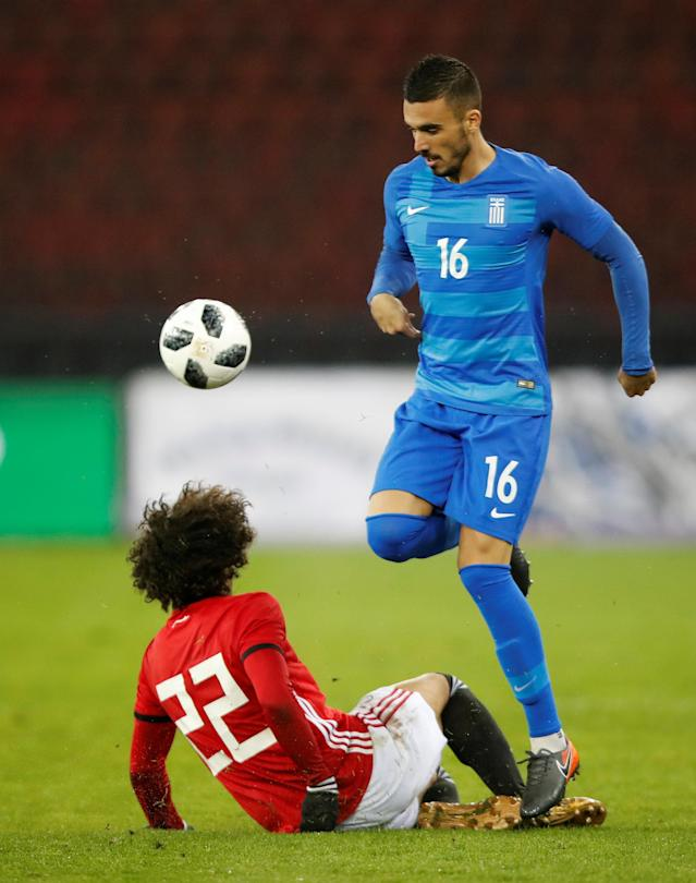 Soccer Football - International Friendly - Egypt vs Greece - Stadion Letzigrund, Zurich, Switzerland - March 27, 2018 Greece's Dimitrios Kourbelis in action with Egypt's Amr Warda REUTERS/Arnd Wiegmann