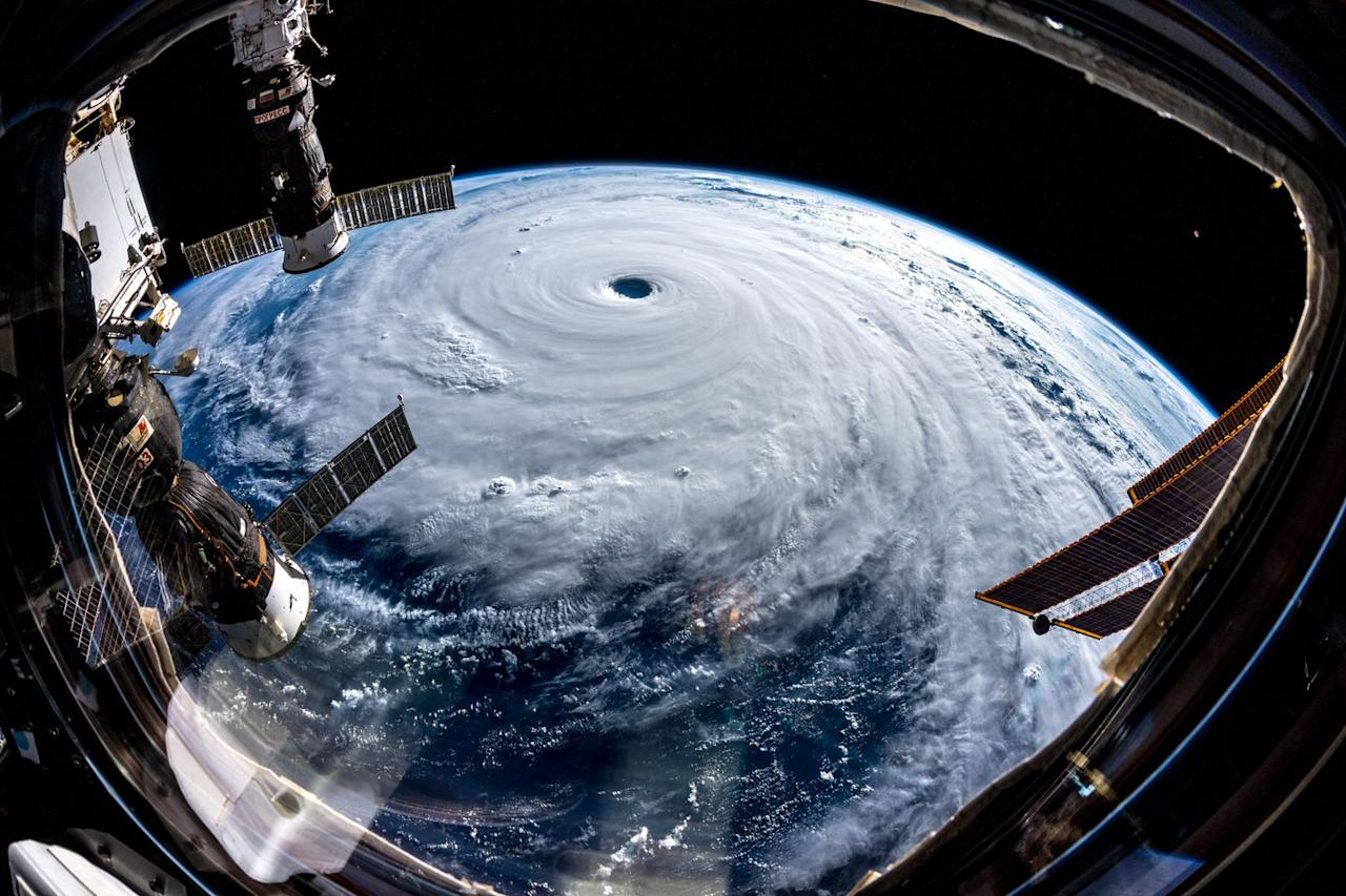 <p>Space telescopes from the ISS Exp 57 are seen hanging over Typhoon Trami.</p>
