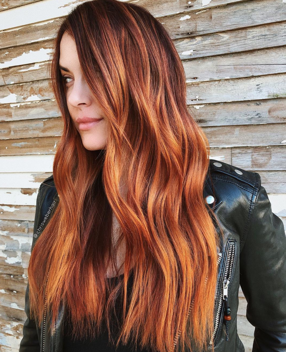 If anyone refers to this as red hair, make a point to correct them that it's <em>actually</em> ginger peach. There's much more going on here than simply red: The dark, almost brunette roots keep it low-maintenance, while the golden and auburn tones prevent the copper color from pulling too orange.