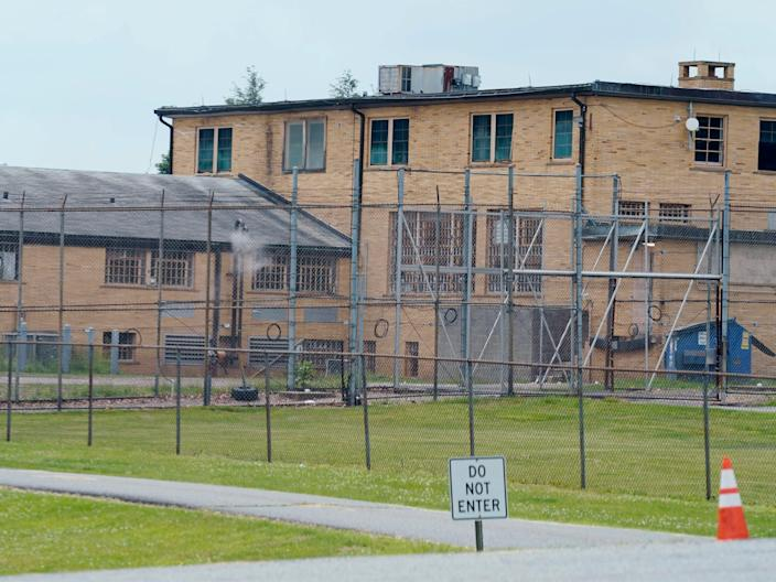 High fences surround buildings on the grounds of the Edna Mahan Correctional Facility for Women in Clinton, New Jersey (AP)