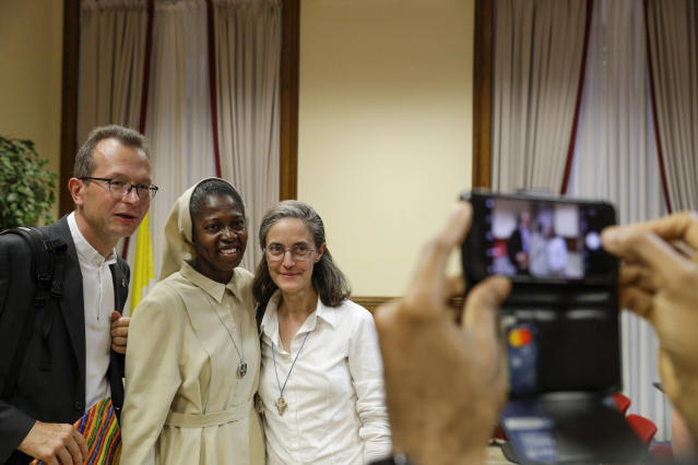 Togolese Sister Makamatine Lembo, center, poses for a photo after she defended her dissertation on the sexual abuse of religious sisters by priests, at the Pontifical Gregorian University, in Rome, Thursday, Sept. 26, 2019. Sister Lembo was awarded summa cum laude, and was praised by her examiners for her courage in examining such a taboo subject. (AP Photo/Gregorio Borgia)