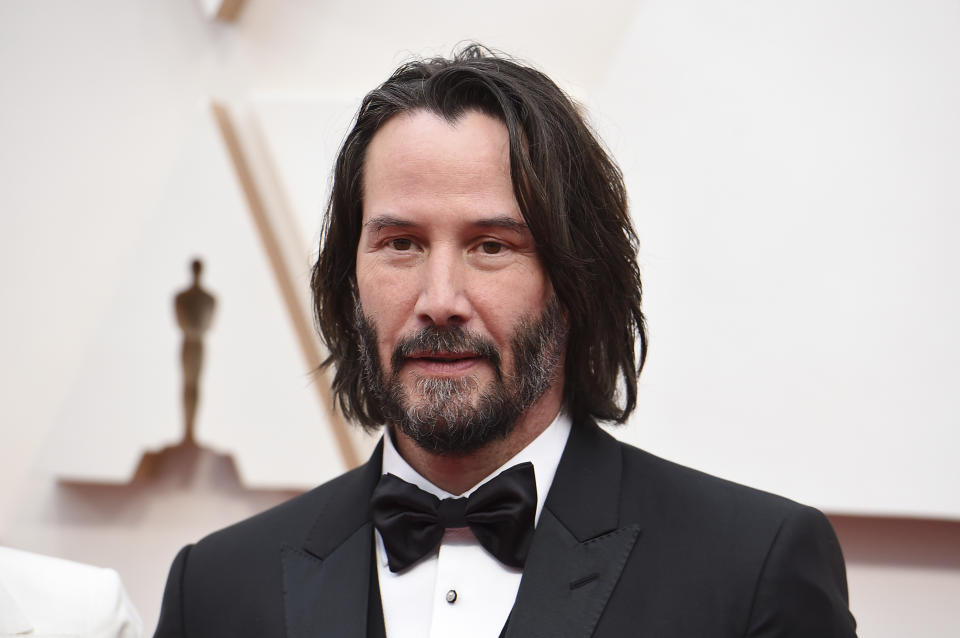 Keanu Reeves arrives at the Oscars on Sunday, Feb. 9, 2020, at the Dolby Theatre in Los Angeles. (Photo by Jordan Strauss/Invision/AP)