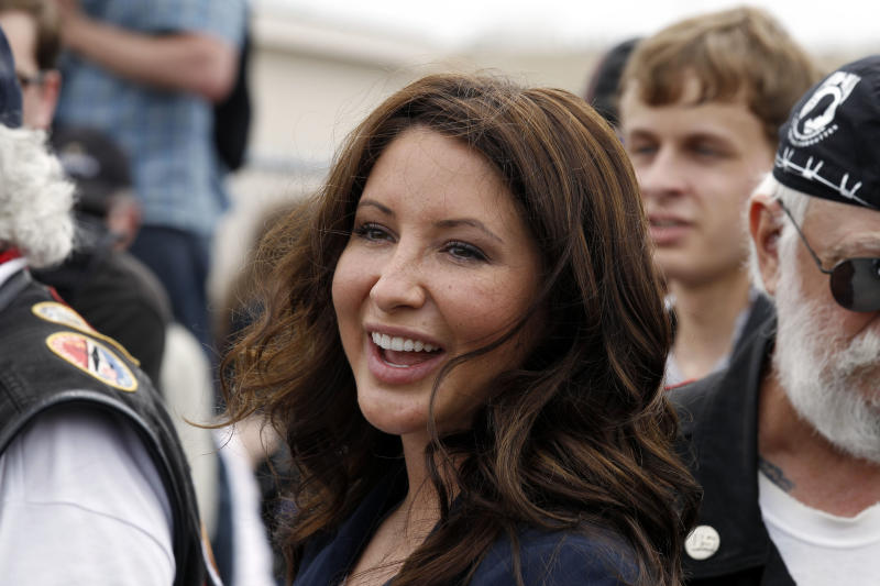 "FILE - In this May 29, 2011 file photo, Bristol Palin, daughter of former GOP vice presidential candidate and Alaska governor Sarah Palin, smiles at the beginning of the Rolling Thunder ride from the Pentagon during the Memorial Day weekend in Washington. Lifetime says it will air 10 episodes of ""Bristol Palin: Life's a Tripp"" later this year. The series will explore the pressures of raising her toddler son, Tripp, as she maintains her close relationship with the larger Palin clan, the network said. (AP Photo/Alex Brandon, File)"