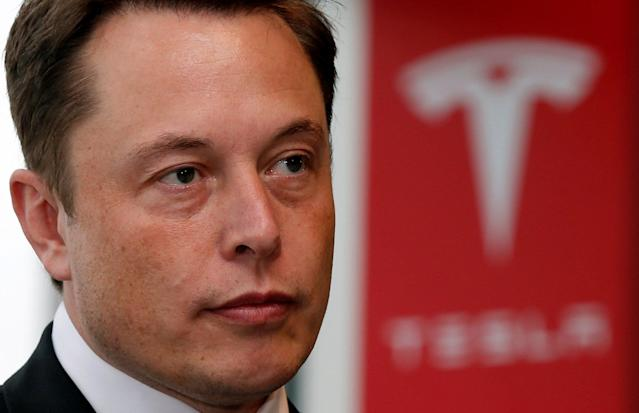 FILE PHOTO: Tesla Motors Inc Chief Executive Elon Musk pauses during a news conference in Tokyo September 8, 2014. REUTERS/Toru Hanai/File Photo