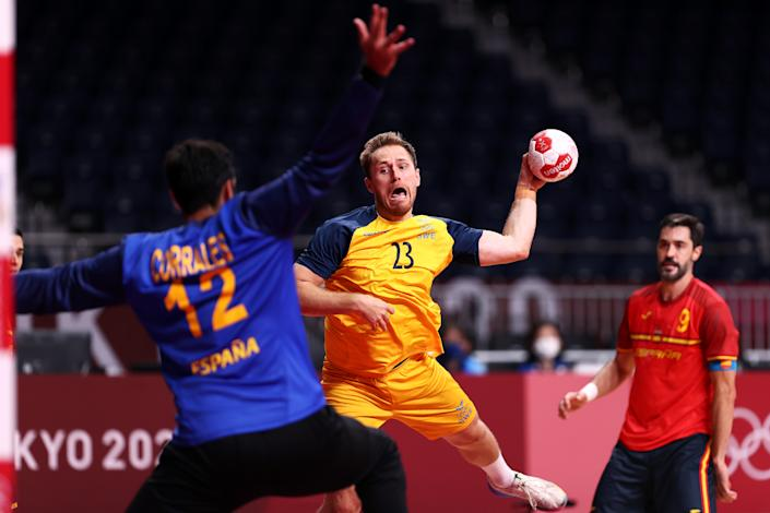 <p>Albin Lagergren of Team Sweden shoots and scores a goal against Rodrigo Corrales Rodal of Team Spain during the Men's Quarterfinal handball match between Sweden and Spain on day eleven of the Tokyo 2020 Olympic Games at Yoyogi National Stadium on August 03, 2021 in Tokyo, Japan. (Photo by Dean Mouhtaropoulos/Getty Images)</p>