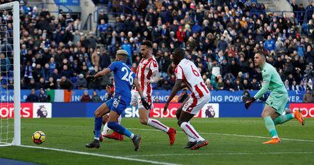 Soccer Football - Premier League - Leicester City vs Stoke City - King Power Stadium, Leicester, Britain - February 24, 2018 Leicester City's Riyad Mahrez attempts to score after having his previous shot saved by Stoke City's Jack Butland Action Images via Reuters/Andrew Boyers