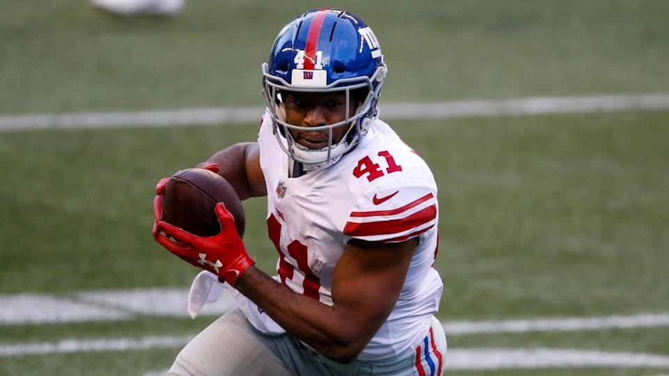Alfred Morris running with ball Giants white uniform