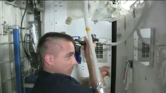 How to Shave Your Head in Space: Astronaut Video