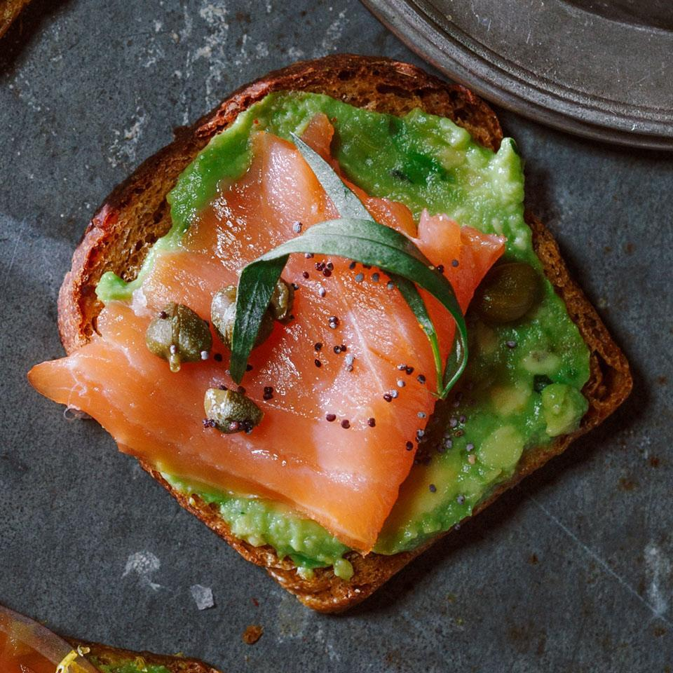 <p>They would have been canapés back in 1979--today they're trendy avocado toasts. Let your guests creatively customize their nibbles by setting out an array of garnishes for this healthy appetizer.</p>