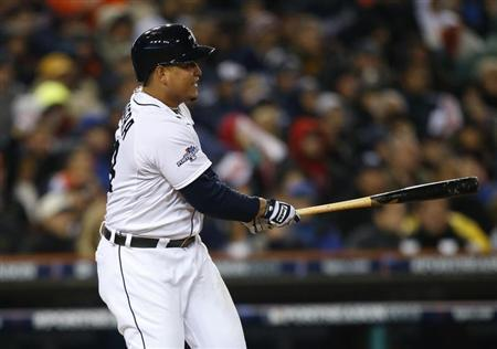 Detroit Tigers third baseman Miguel Cabrera (24) hits an RBI single against the Boston Red Sox during the fifth inning in game five of the American League Championship Series baseball game at Comerica Park. Mandatory Credit: Rick Osentoski-USA TODAY Sports