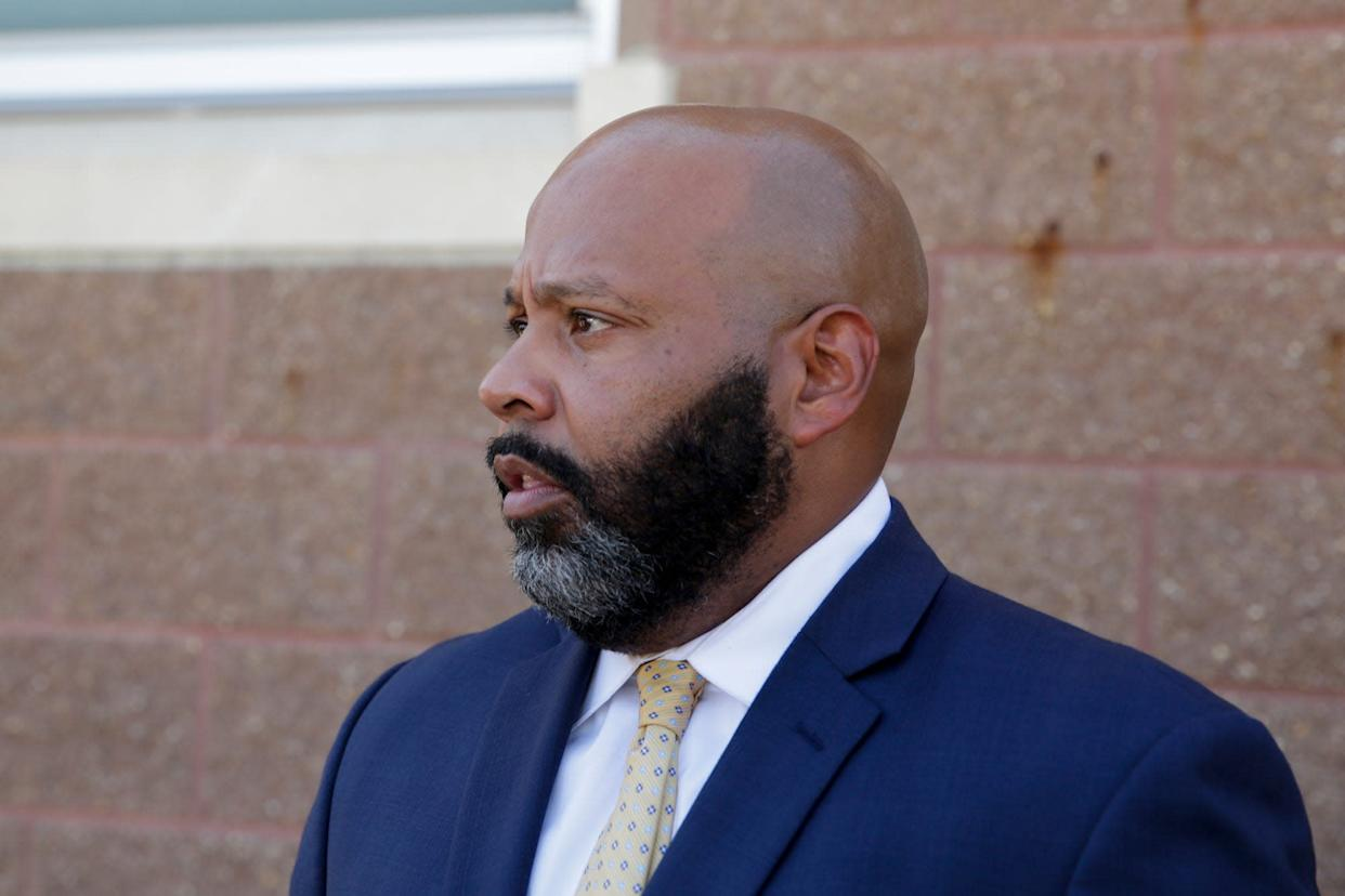 Attny. Terrance Kinnard talks about his client, Michael Barnett's release from the Tippecanoe County Sheriff's office, Wednesday, Sept. 18, 2019 in Lafayette. The Tippecanoe criminal magistrate issued warrants for Barnett's arrest on Tuesday on charges of abandoning their adoptive daughter in Lafayette in 2013. A warrant is still outstanding for Barnett's ex-wife, Kristine Barnett.