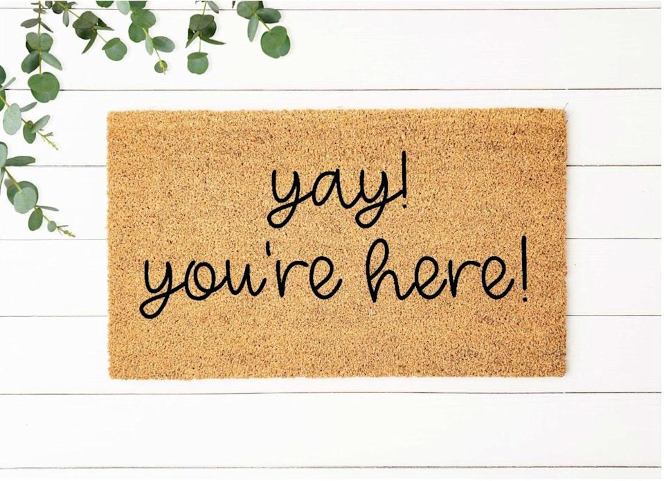 <p>Keep it positive with this <span>Yay You're Here Doormat</span> ($20+, originally $28+).</p>