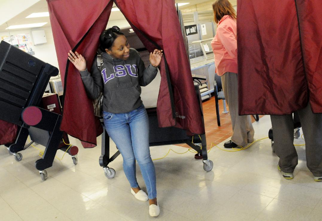 Shankeshia Miller smiles as she walks out the voting booth after casting her vote at Youree Middle School Tuesday, Nov. 6, 2012, in Shreveport, Louisiana. (AP Photo/The Shreveport Times, Henrietta Wildsmith)