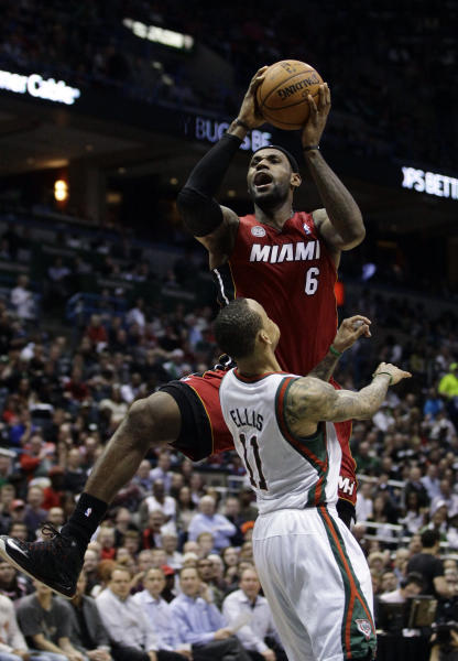 Miami Heat's LeBron James, top, shoots over Milwaukee Bucks' Monta Ellis (11) during the second half of Game 3 in their first-round NBA basketball playoff series on Thursday, April 25, 2013, in Milwaukee. The Heat won 104-91 to take a 3-0 lead in the series. (AP Photo/Aaron Gash)