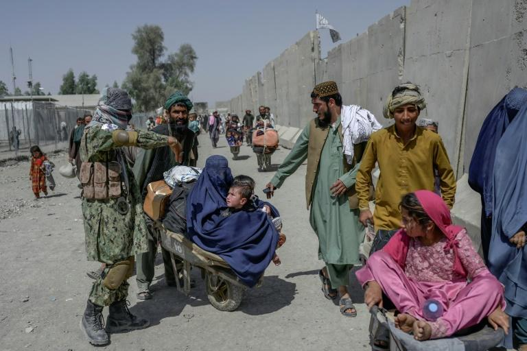 Scores of Afghans are eager to leave a country on the verge of economic collapse since the Islamists seized power in mid-August and foreign aid money dried up (AFP/BULENT KILIC)