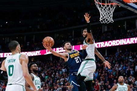 Nov 5, 2018; Denver, CO, USA; Boston Celtics guard Kyrie Irving (11) defends against Denver Nuggets guard Jamal Murray (27) in the fourth quarter at Pepsi Center. Mandatory Credit: Isaiah J. Downing-USA TODAY Sports