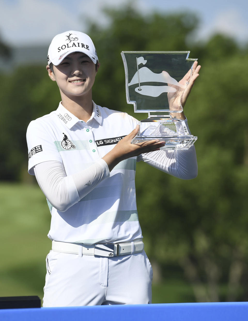 Sung Hyun Park holds up the trophy after winning the LPGA Walmart NW Arkansas Championship golf tournament, Sunday, June 30, 2019, in Rogers, Ark. (AP Photo/Michael Woods)