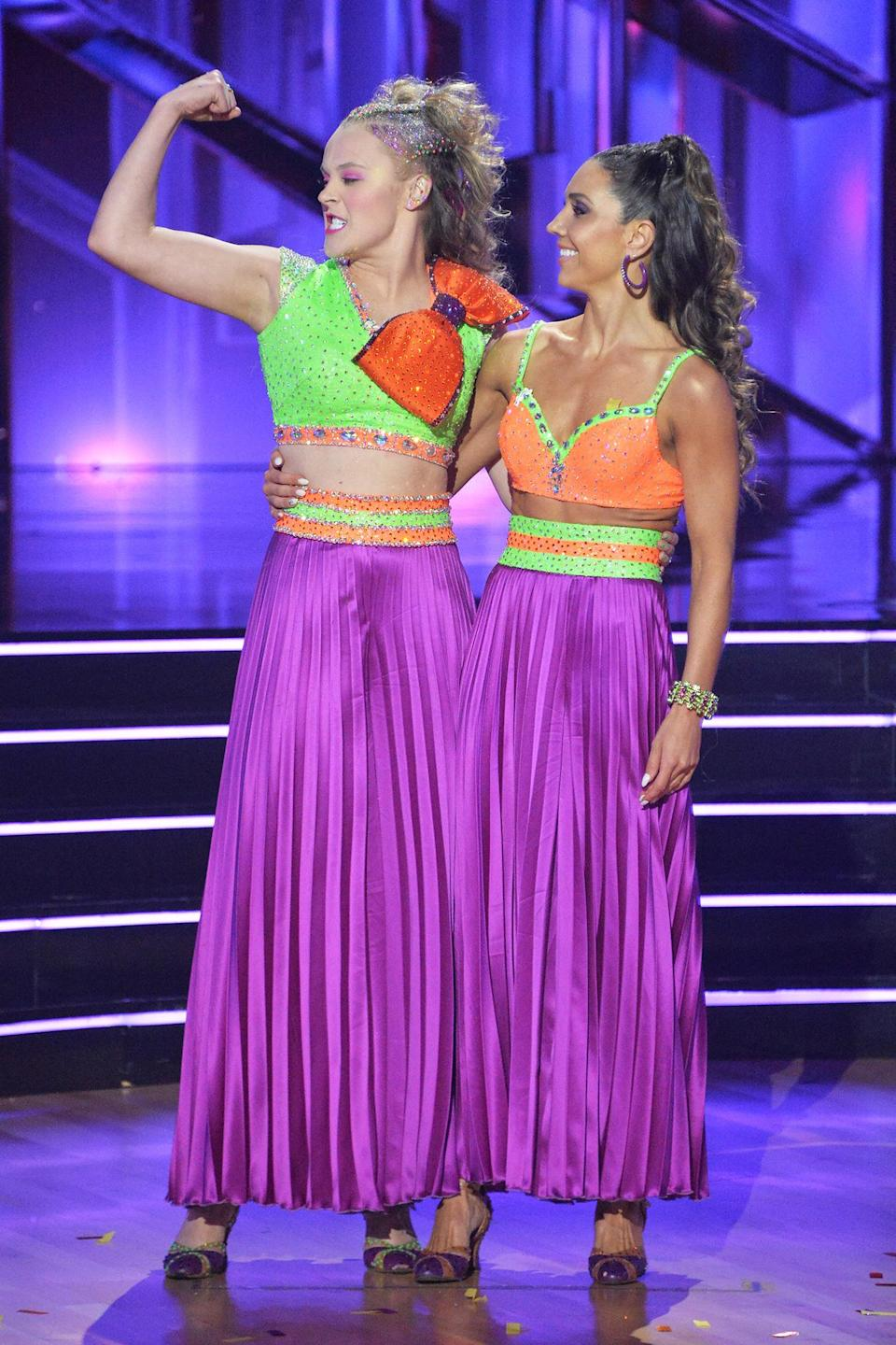 <p>JoJo Siwa and Jenna Johnson celebrate their <em>Dancing with the Stars</em> debut live from the Los Angeles ballroom on Sept. 20. </p>