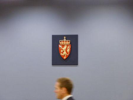 Fredrik Sejersted, NorwayÕs Attorney General, passes underneath the symbol of the Norwegian state in a courtroom in the district court in Oslo, Norway November 14, 2017. REUTERS/Gwladys Fouche