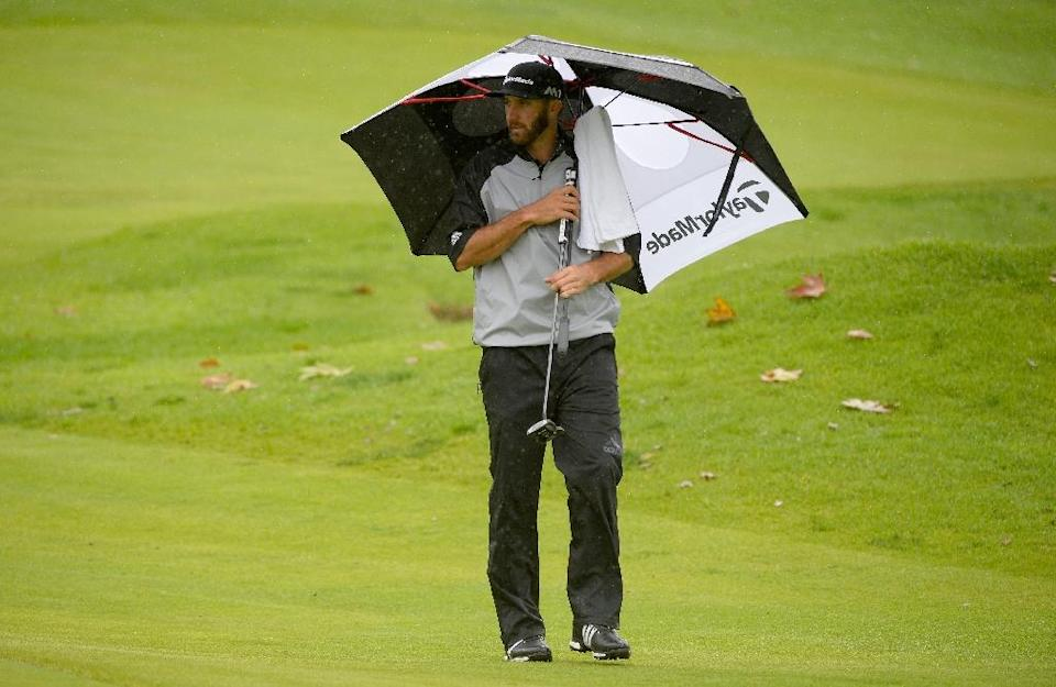 Dustin Johnson prepares to putt on the fourth hole during a continuation of the second round at the Genesis Open in Pacific Palisades, California (AFP Photo/ROBERT LABERGE)