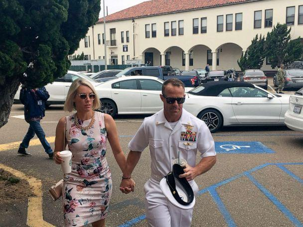 PHOTO: Navy Special Operations Chief Edward Gallagher walks with his wife, Andrea Gallagher, left, as they arrive on Naval Base San Diego, June 20, 2019. (Julie Watson/AP)