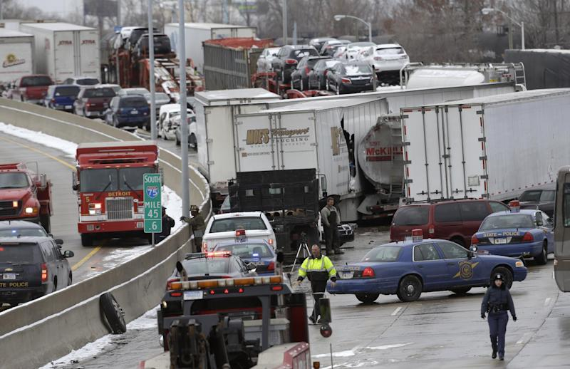 A section of multi-vehicle accident on Interstate 75 is shown in Detroit, Thursday, Jan. 31, 2013. Snow squalls and slippery roads led to a series of accidents that left at least three people dead and 20 injured on a mile-long stretch of southbound I-75. More than two dozen vehicles, including tractor-trailers, were involved in the pileups. (AP Photo/Paul Sancya)