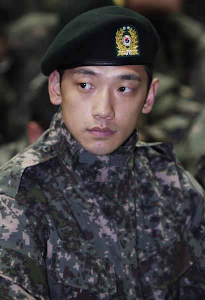 FILE - In this Oct. 14, 2011 file photo, South Korean pop singer Rain appears to attend an event at an army training center in Uijeongbu, South Korea. Rain is facing questions after paparazzi photos showed him out on the town with a top actress. Seoul's Defense Ministry said Wednesday, Jan. 2, 2013 it is investigating whether Rain broke military rules by meeting actress Kim Tae-hee while on duty. (AP Photo/Yomnhap, Lim Byung-shick, File) KOREA OUT