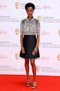 <p>Letitia Wright goes for a preppy mini comprising of an almost hypnotic, embellished shirt and understated skirt.</p>