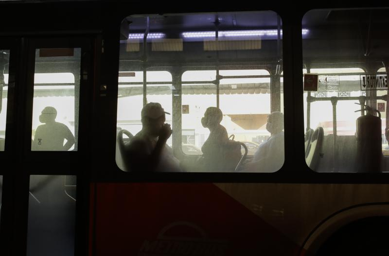 Commuters wearing face masks amid the new coronavirus pandemic ride on a bus at the main terminal in Panama City, Monday, June 1, 2020. The Central American country reactivated a second block of activities on Monday, significantly easing mobility restrictions in place since March. (AP Photo/Arnulfo Franco)
