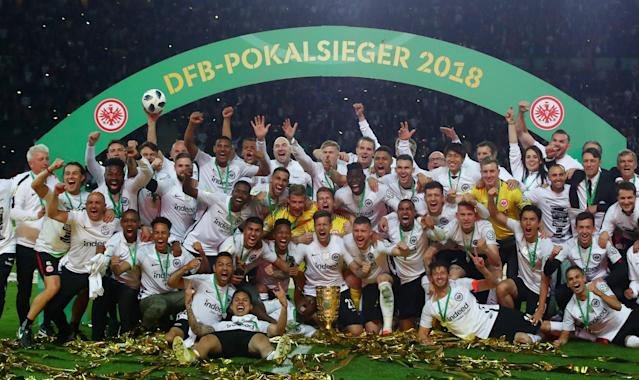 Soccer Football - DFB Cup Final - Bayern Munich vs Eintracht Frankfurt - Olympiastadion, Berlin, Germany - May 19, 2018 Eintracht Frankfurt celebrate with the trophy after winning the DFB Cup REUTERS/Michael Dalder DFB RULES PROHIBIT USE IN MMS SERVICES VIA HANDHELD DEVICES UNTIL TWO HOURS AFTER A MATCH AND ANY USAGE ON INTERNET OR ONLINE MEDIA SIMULATING VIDEO FOOTAGE DURING THE MATCH.