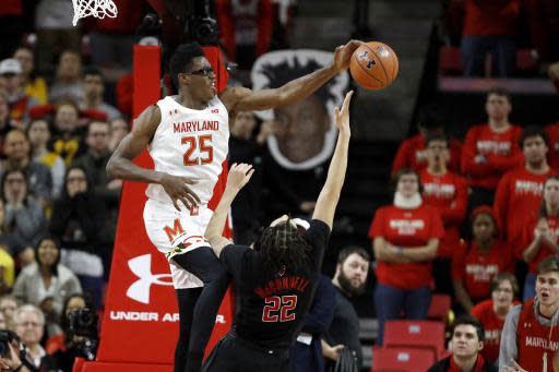 Maryland forward Jalen Smith (25) blocks a shot by Rutgers guard Caleb McConnell (22) during the second half of an NCAA college basketball game Tuesday, Feb. 4, 2020, in College Park, Md. Maryland won 56-51. (AP Photo/Julio Cortez)