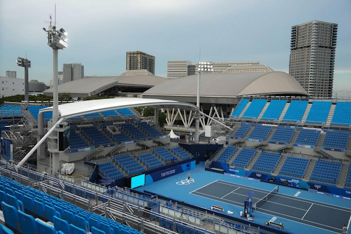 Tennis practice at an empty Ariake Tennis Park in Tokyo on July 20, 2021. (Chang W. Lee/The New York Times)