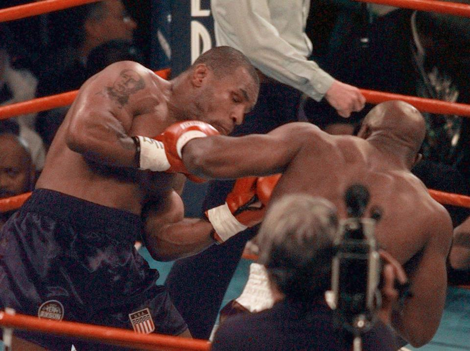 <p>Evander Holyfield, right, delivers a punch to Mike Tyson in the first round of their WBA Heavyweight match Saturday, June 28, 1997, at the MGM Grand in Las Vegas. (AP Photo/Jack Smith) </p>