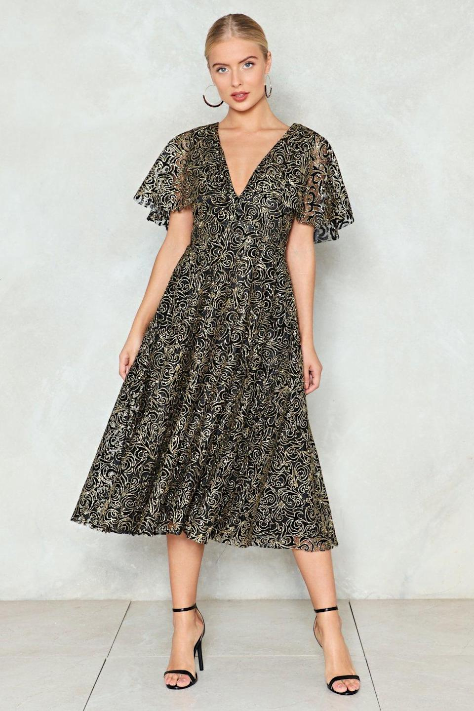 """<p>$66, Nasty Gal</p><p><a rel=""""nofollow noopener"""" href=""""http://www.nastygal.com/cape-going-glitter-dress/AGG94297.html"""" target=""""_blank"""" data-ylk=""""slk:Buy Now"""" class=""""link rapid-noclick-resp"""">Buy Now</a><br></p>"""