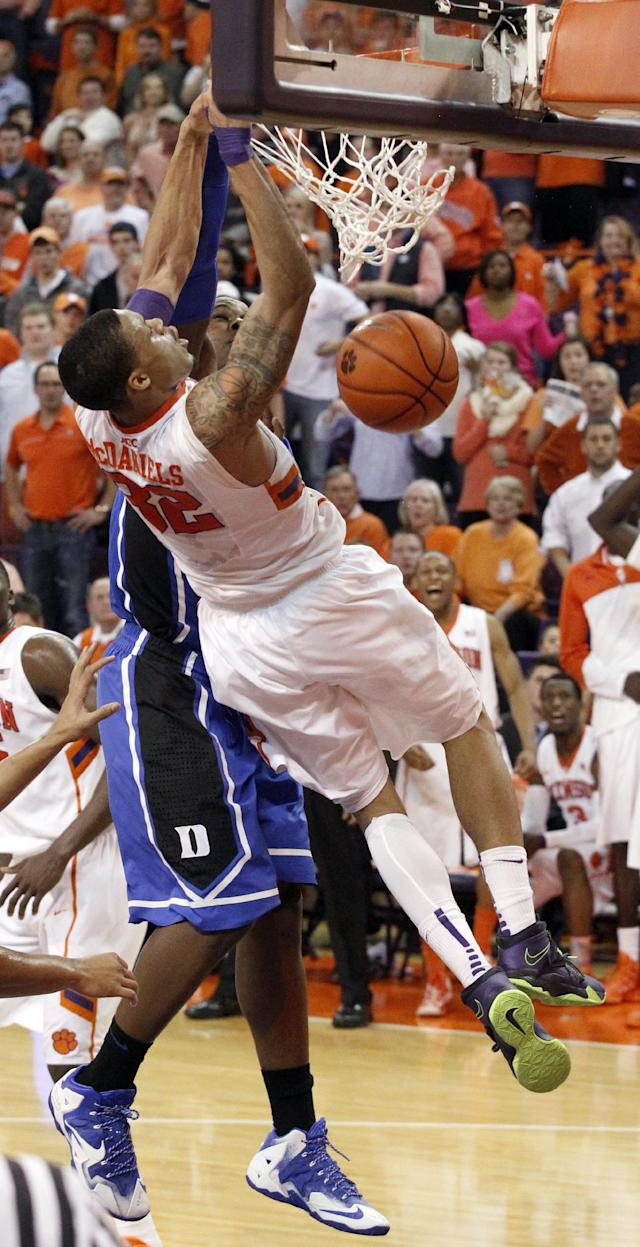Clemson's K.J. McDaniels (32) dunks the ball over Duke's Semi Ojeleye (20) in the second half of an NCAA college basketball game in Clemson, S.C., on Saturday, Jan. 11, 2014. (AP Photo/The Independent-Mail, Sefton Ipock)