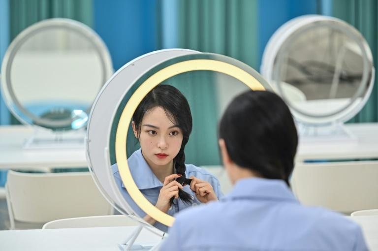 Chinese entertainers wanting mainstream success have little choice but to agree with the state, whose disapproval can ultimately sink their careers (AFP/Hector RETAMAL)