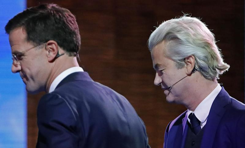 Right-wing populist leader Geert Wilders and Dutch Prime Minister Mark Rutte, left, leave the stage after a national televised debate, the first head-to-head meeting of the two political party leaders since the start of the election campaign, at Erasmus University in Rotterdam, Netherlands, Monday, March 13, 2017. (Yves Herman POOL via AP)