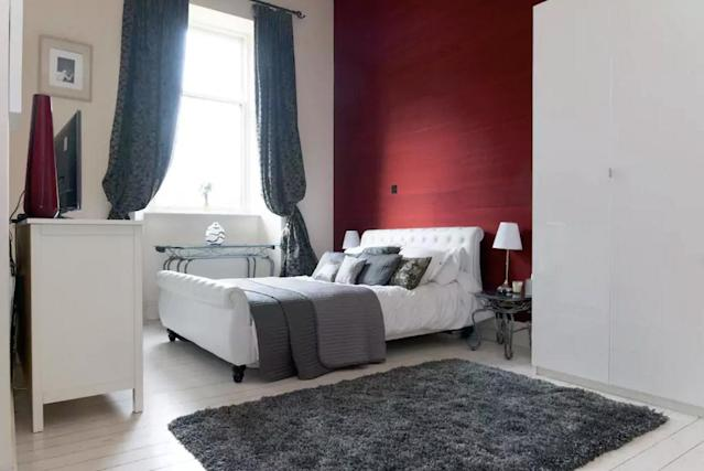 <p>The home has two bedrooms, including this master with a king mattress and a sofa bed. </p>