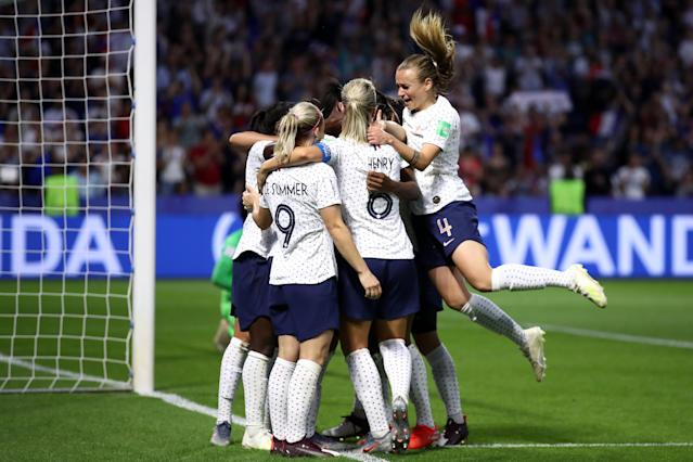 Valerie Gauvin of France celebrates her team's first goal with team mates during the 2019 FIFA Women's World Cup France Round Of 16 match between France and Brazil at Stade Oceane on June 23, 2019 in Le Havre, France. (Photo by Alex Grimm/Getty Images)