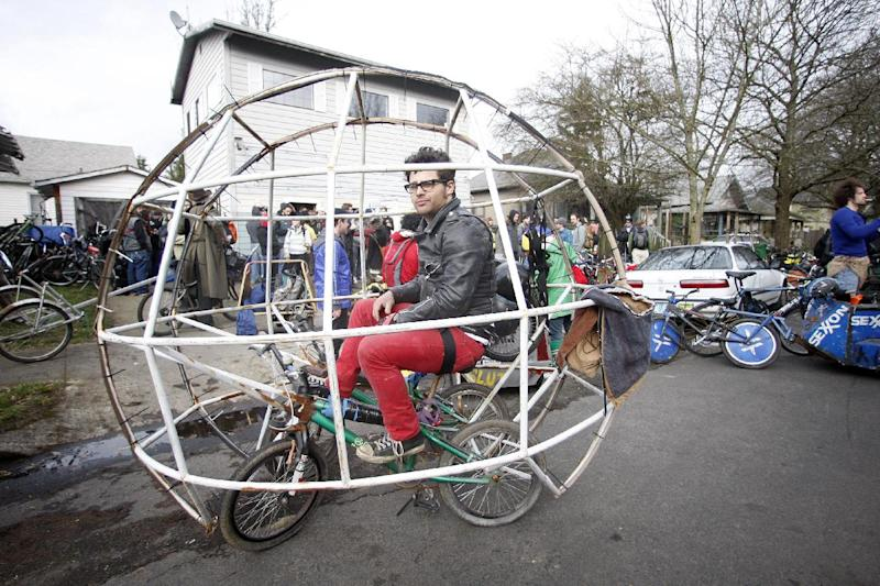 """Zane Fischer, sits in his hamster ball bike before a """"Ben Hur""""-like chariot race at Chariot Wars during a three-day Mini Bike Winter Olympics Saturday, Feb.18, 2012, in Portland, Ore. Armed, variously, with all manner of foam-padded apparatus, at least five teams did battle on Saturday under gray skies for the pleasure of hoisting a three-foot-tall, homemade skull-bearing piece of welded junk, called the """"Ben Hurt"""" trophy. (AP Photo/Rick Bowmer)"""