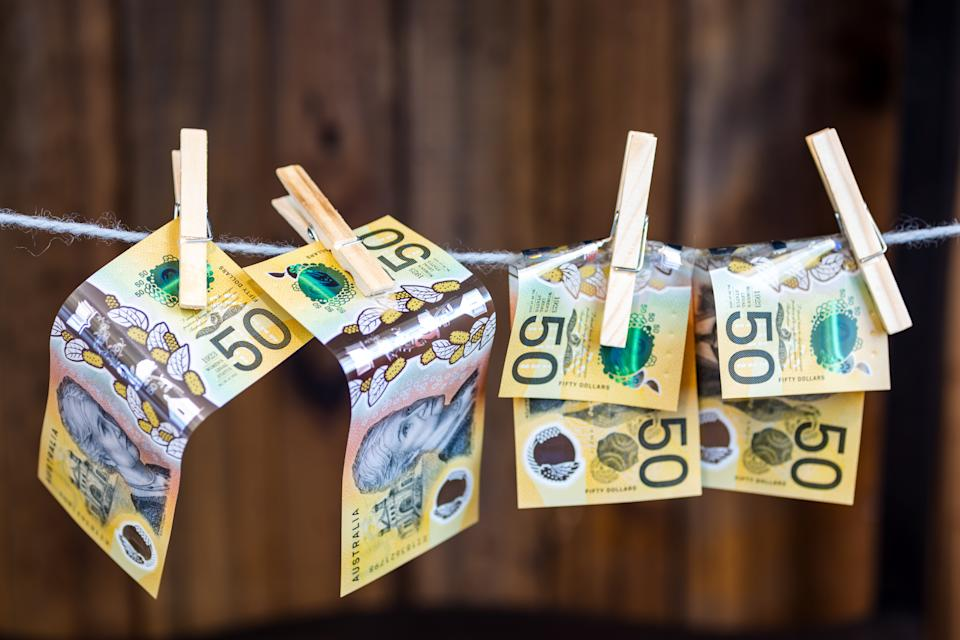 Money pinned on a washing line