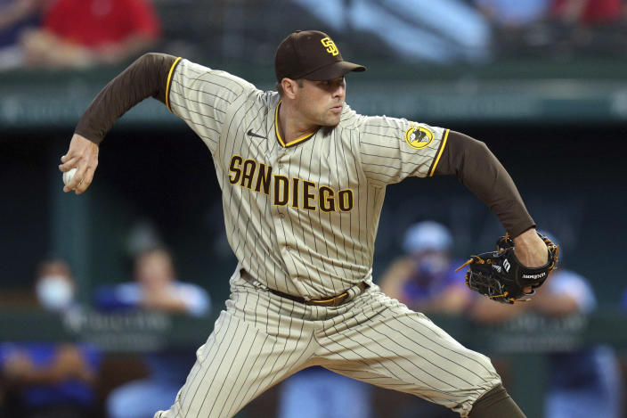San Diego Padres pitcher Craig Stammen throws in the first inning after starting pitcher Adrian Morejon left the baseball game against the Texas Rangers on Sunday, April 11, 2021, in Arlington, Texas. (AP Photo/Richard W. Rodriguez)