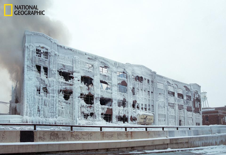 """A warehouse caught fire in the Bridgeport neighborhood in Chicago last month. As the firemen doused it in water, it froze against the building, encasing it in thick ice. (Photo and caption Courtesy Reuben Wu / National Geographic Your Shot) <br> <br> <a href=""""http://ngm.nationalgeographic.com/your-shot/weekly-wrapper"""" rel=""""nofollow noopener"""" target=""""_blank"""" data-ylk=""""slk:Click here"""" class=""""link rapid-noclick-resp"""">Click here</a> for more photos from National Geographic Your Shot."""
