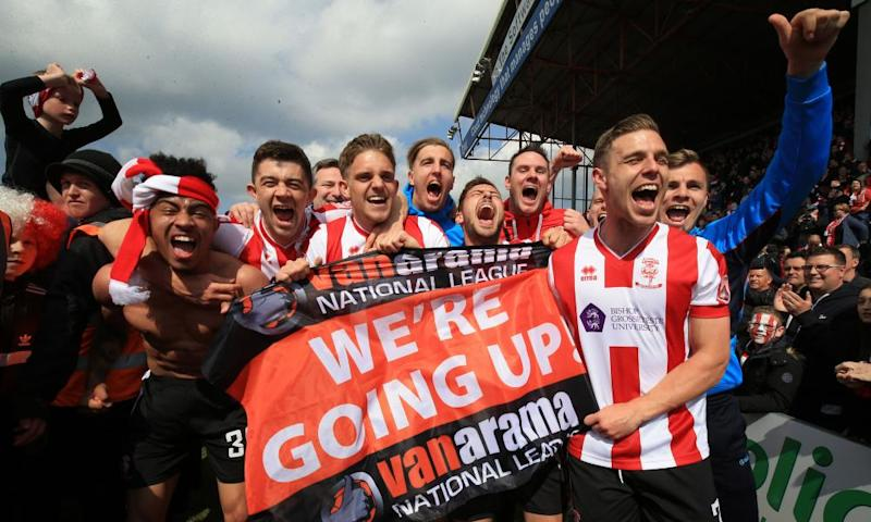 Lincoln City's players celebrate their promotion to the Football League.