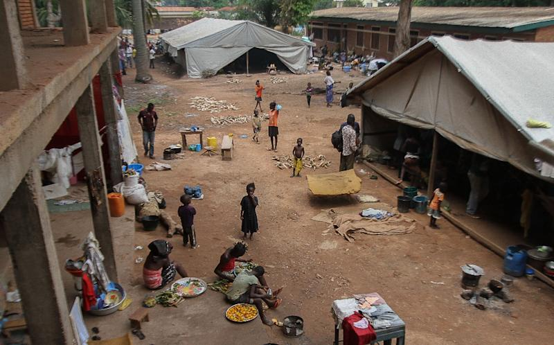 People go about their daily chores in the Pope Jean XIII camp in Bangui (AFP Photo/Edouard Dropsy)