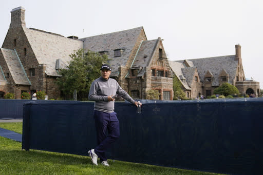 Sami Valimaki, of Finland, waits outside the clubhouse before practicing for the U.S. Open Championship golf tournament, Tuesday, Sept. 15, 2020, at the Winged Foot Golf Club in Mamaroneck, N.Y. (AP Photo/Charles Krupa)